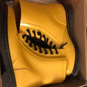 Yellow Dr. Martens rain boots